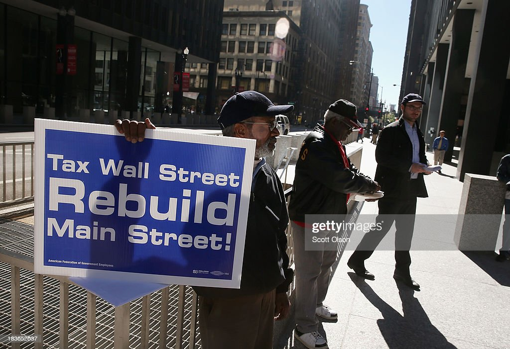 Retired school teacher Mack Dailey (L) participates in a protest and prayer vigil held to call for an end to the federal government shutdown on October 8, 2013 in Chicago, Illinois. The protest was organized by the Rev. Jesse Jackson and the Rainbow PUSH Coalition as well as local labor, faith and community leaders.