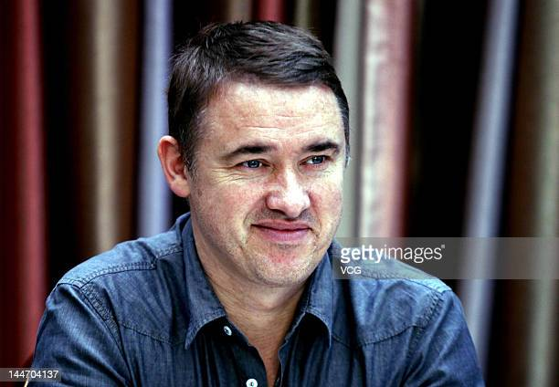 Retired Scottish professional snooker player Stephen Hendry attends a press conference to promote Chinese Eightball on May 17 2012 in Lanzhou Gansu...