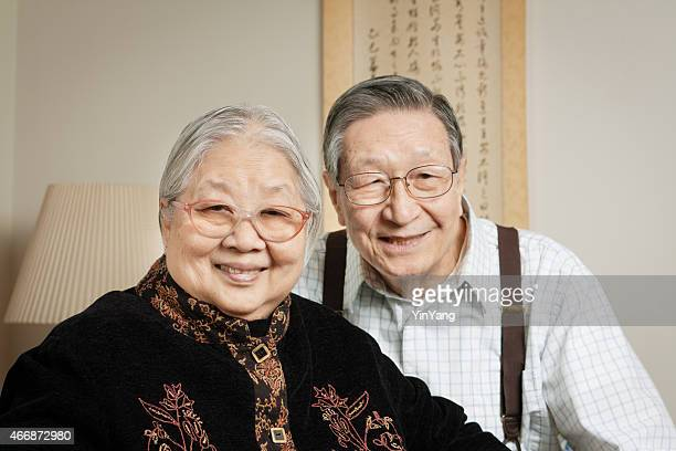 Retired Senior Asian Couple, Happy Chinese Grandparents Relaxing at Home