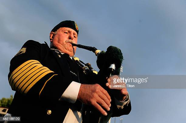 Retired Sergeant First Class Robert J White plays a bagpipe prior to Military Appreciation Night during the first day of the WinstonSalem Open at...