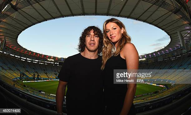 Retired Spanish International Carles Puyol and Brazilian supermodel Gisele Bundchen pose for a photo ahead of their unveiling of the FIFA World Cup...