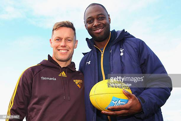 Retired Spurs captain Ledley King poses with Sam Mitchell of the Hawks during a Tottenham Hotspur player visit to the Hawthorn Hawks AFL team at...