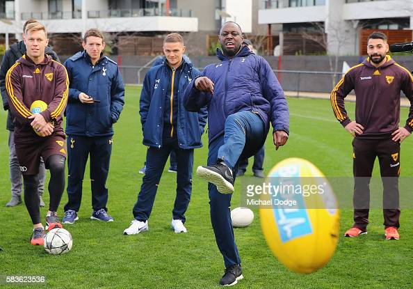 Retired Spurs captain Ledley King reacts after kicking an AFL Football during a Tottenham Hotspur player visit to the Hawthorn Hawks AFL team at...
