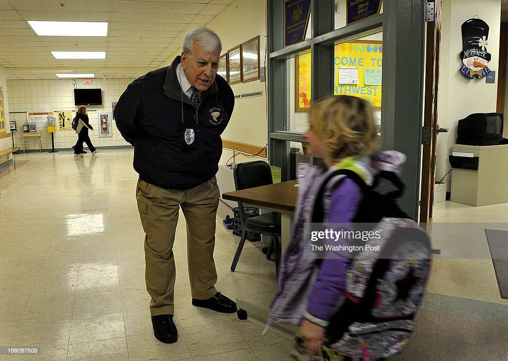 Retired state trooper Al Vish, age 70, chats with a student at Northwest E.S. in Butler. He's wearing a gun but he keeps it under his coat so as to not alarm children. Schools in Butler, PA are using retired state troopers to guard their schools in the wake of the Newtown, CT shootings. Photo by Michael S. Williamson/The Washington Post via Getty Images