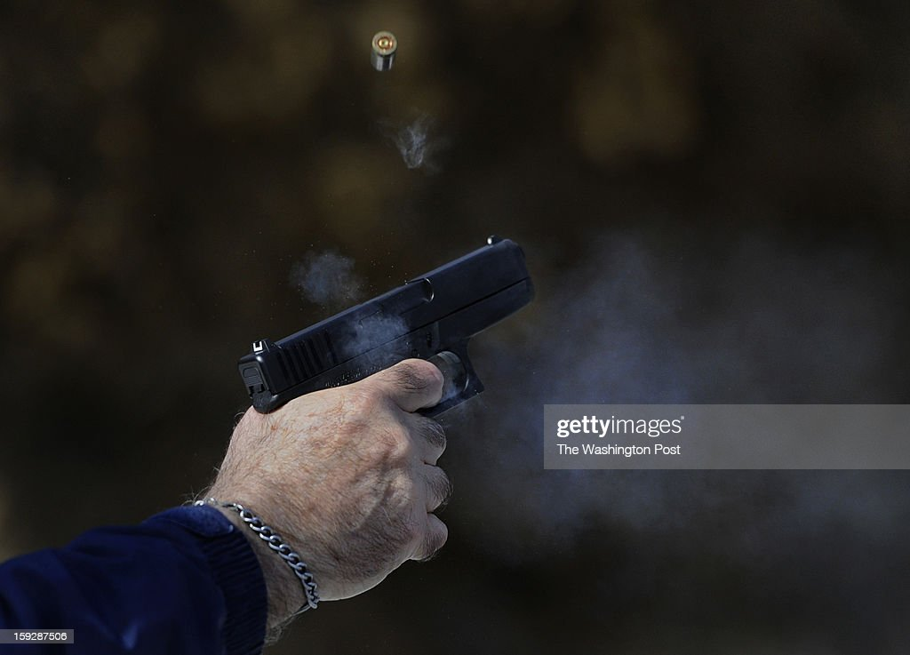 Retired state trooper Al Vish, age 70, fires a round from his Glock handgun during a qualifying session at the county gun range. All troopers taking part in the program to place armed personnel at local schools had to be certified. Vish passed easily. Schools in Butler, PA are using retired state troopers to guard their schools in the wake of the Newtown, CT shootings. Photo by Michael S. Williamson/The Washington Post via Getty Images