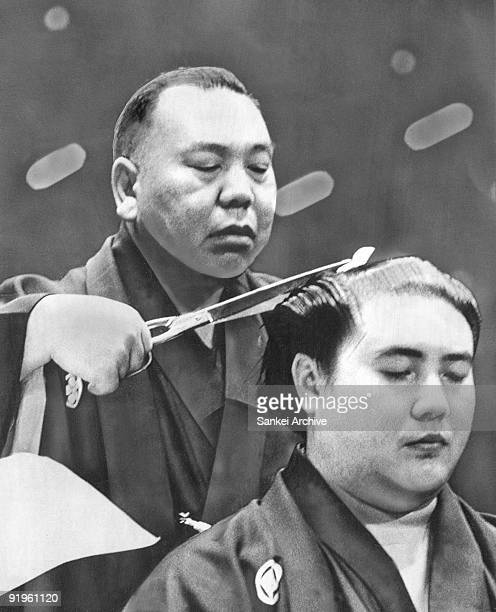 Retired Sumo grand champion Taiho is being his hair cut during the hair cutting ceremony at Kuramae Kokugikan on October 2 1971 in Tokyo Japan