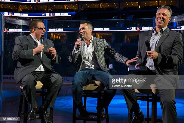 Retired Tampa Bay Lightning player Martin St Louis speaks with former teammate Dave Andreychuk and Executive Director of Community Hockey Development...