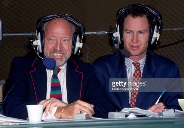 Retired tennis player John McEnroe of the USA commentating at Wimbledon with sports journalist Bud Collins at the Wimbledon Lawn Tennis Championships...