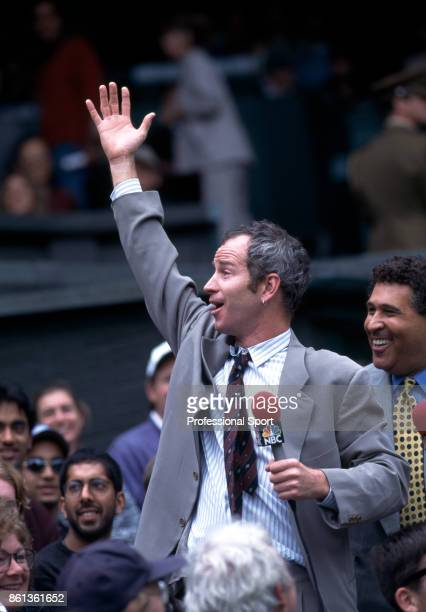 Retired tennis player John McEnroe of the USA entertaining the crowd on Centre Court whilst commentating for NBC during the Wimbledon Lawn Tennis...