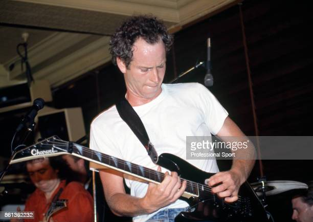 Retired tennis player John McEnroe performing with his band The Johnny Smyth Band during the US Open players party at the Hard Rock Cafe in New York...