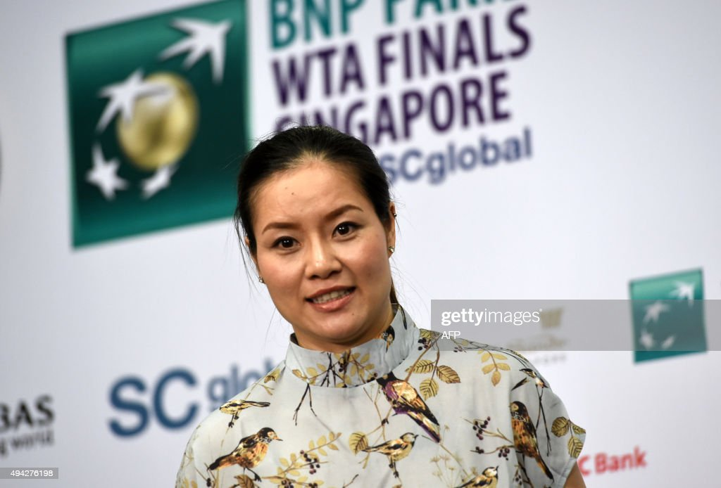 Retired tennis player Li Na of China is pictured as she attends a press conference on the sidelines of the WTA Finals tennis tournament in Singapore on October 26, 2015. / AFP / ROSLAN RAHMAN