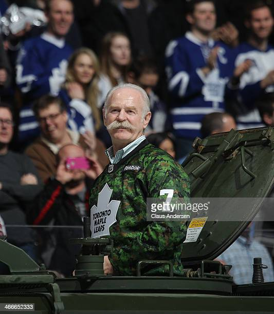 Retired Toronto Maple Leaf legend Lanny McDonald delivers one of the ceremonial pucks on Military appreciation nite prior to an NHL game between the...