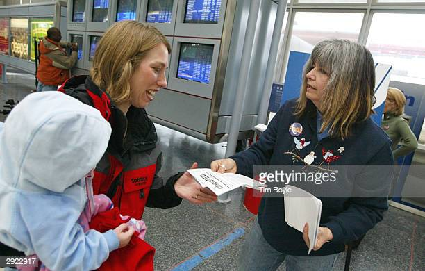 Retired United Airlines flight attendant Jackie Matazzoni with 31 years of service distributes informational leaflets to a current United Airlines...