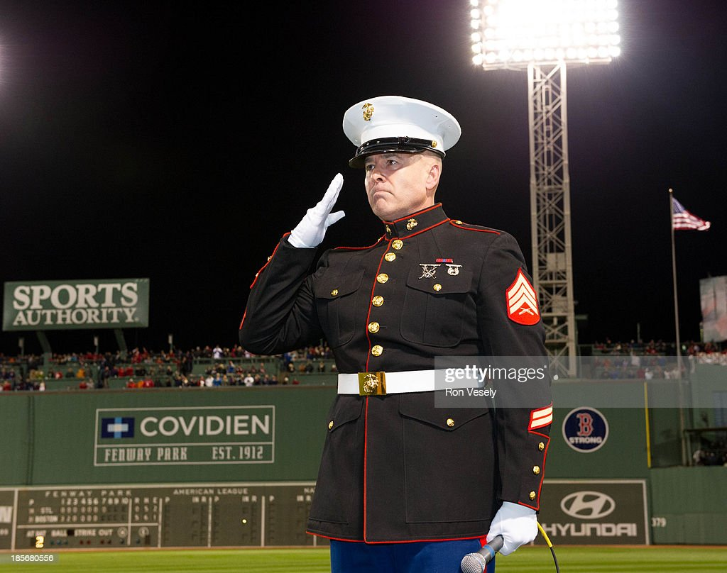 Retired United States Marine Corps Sgt. Dan Clark sings God Bless America during the seventh inning during Game 1 of the 2013 World Series between the Boston Red Sox and the St. Louis Cardinals on Wednesday, October 23, 2013 at Fenway Park in Boston, Massachusetts.