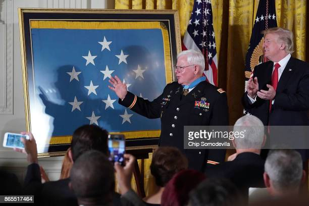 Retired US Army Capt Gary Rose receives a standing ovation after being awarded the Medal of Honor by US President Donald Trump during a ceremony in...