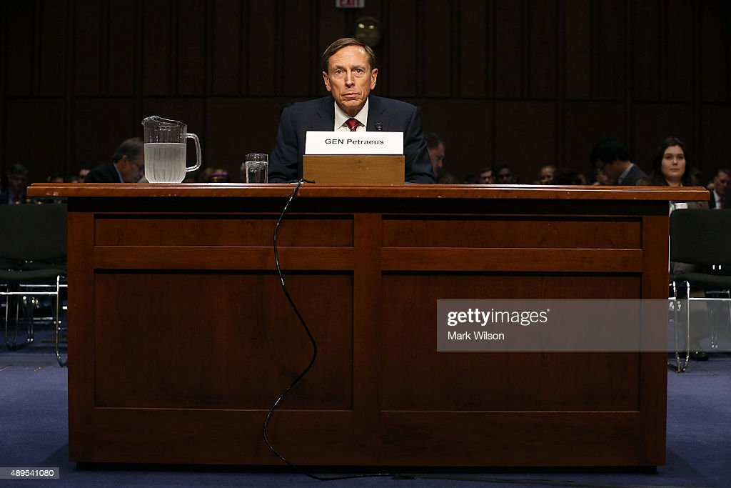 Retired US Army Gen. <a gi-track='captionPersonalityLinkClicked' href=/galleries/search?phrase=David+Petraeus&family=editorial&specificpeople=175826 ng-click='$event.stopPropagation()'>David Petraeus</a> listens to questions during a Senate Armed Services Committee hearing on Capitol Hill September 22, 2015 in Washington, DC. The hearing focused on United States Middle East Policy.
