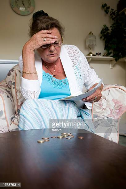 retired woman stresses over money at home