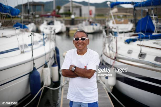 Retiree Fujio Umemoto poses for a photograph at a marina in Hayama Kanagawa Japan on Saturday June 24 2017 Record numbers of overseas travelers are...