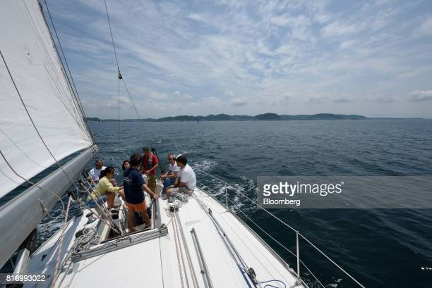 Retiree Fujio Umemoto rear left and his friends sail a yacht near Hayama Kanagawa Japan on Saturday June 24 2017 Record numbers of overseas travelers...