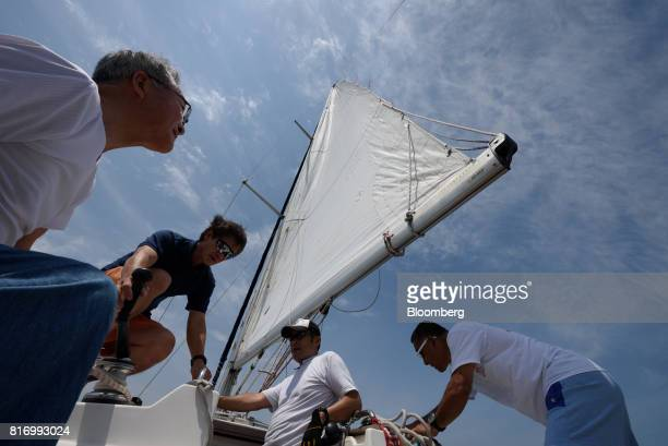 Retiree Fujio Umemoto right and his friends sail a yacht near Hayama Kanagawa Japan on Saturday June 24 2017 Record numbers of overseas travelers are...