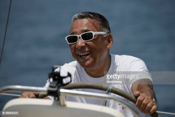 Retiree Fujio Umemoto sails a yacht near Hayama Kanagawa Japan on Saturday June 24 2017 Record numbers of overseas travelers are visiting Japan but...
