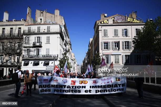 Retirees hold a banner reading 'Immediate raise of pensions' as they take part in a demonstration for better pensions and the protection of their...