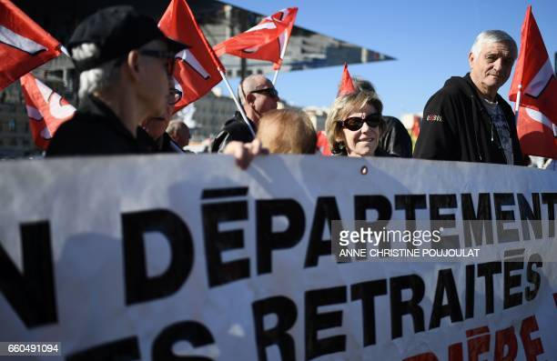 Retirees take part in a demonstration for better pensions and the protection of their purchasing power in Marseille on March 30 2017 / AFP PHOTO /...