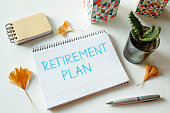 retirement plan written in notebook on white table