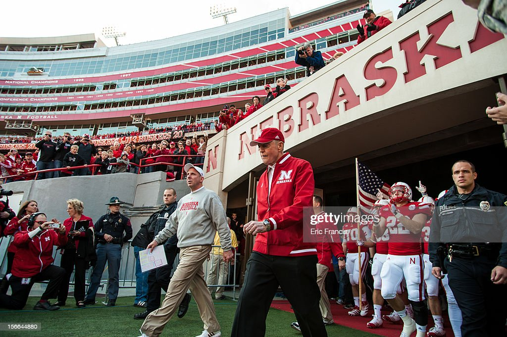 Retiring Athletic Director and former coach Tom Osborne, along side Nebraska Cornhuskers head coach <a gi-track='captionPersonalityLinkClicked' href=/galleries/search?phrase=Bo+Pelini&family=editorial&specificpeople=4682479 ng-click='$event.stopPropagation()'>Bo Pelini</a>, lead the team onto the field to face the Minnesota Golden Gophers before their game at Memorial Stadium on November 17, 2012 in Lincoln, Nebraska. Nebraska won 38-14.