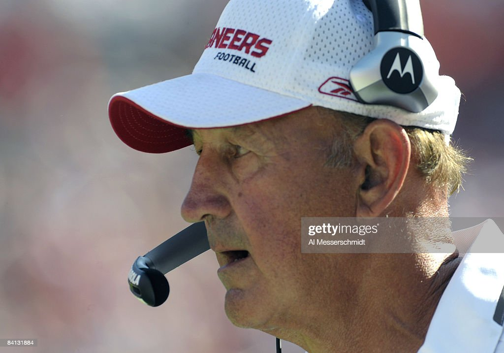 Retiring defensive coordinator Monte Kiffin of the Tampa Bay Buccaneers watches play against the Oakland Raiders at Raymond James Stadium on December...