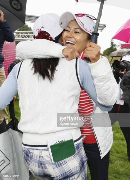Retiring former world No 1 Ai Miyazato hugs compatriot Ayako Uehara after the final round of the Evian Championship in France on Sept 17 2017 Uehara...