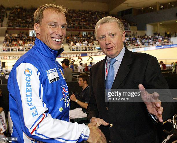 Retiring French Olympic Champion Florian Rousseau chats with UCI President Hein Verbruggen after Rousseau's last race at the UCI Track Cycling World...