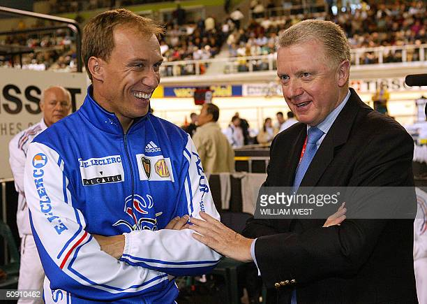 Retiring French Olympic Champion Florian Rousseau shares a joke with UCI President Hein Verbruggen after Rousseau's last race at the UCI Track...