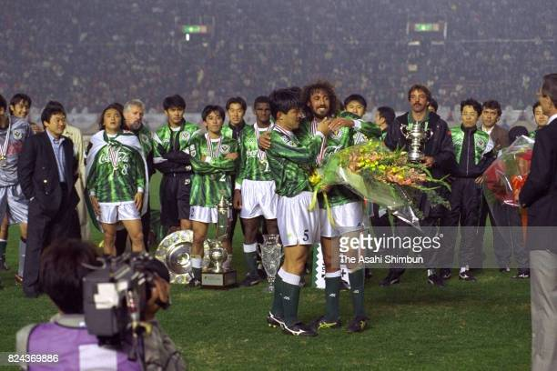 Retiring Hisashi Kato of Verdy Kawasaki is presented a flower bouquet by Ruy Ramos after the JLeague Championship second leg match between Verdy...