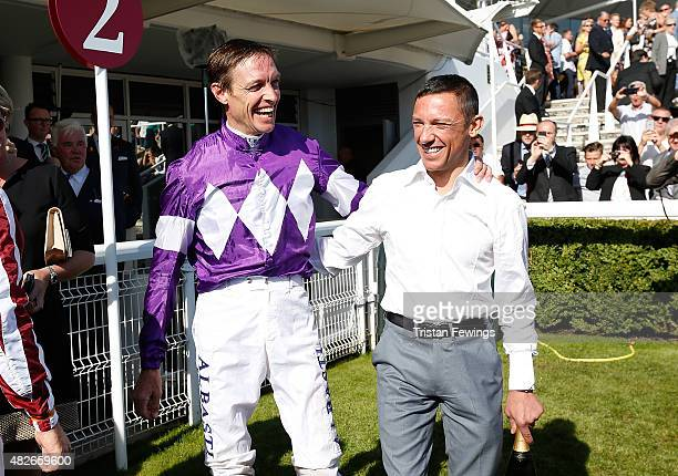 Retiring jockey Richard Hughes and Frankie Dettori on day five of the Qatar Goodwood Festival at Goodwood Racecourse on August 1 2015 in Chichester...