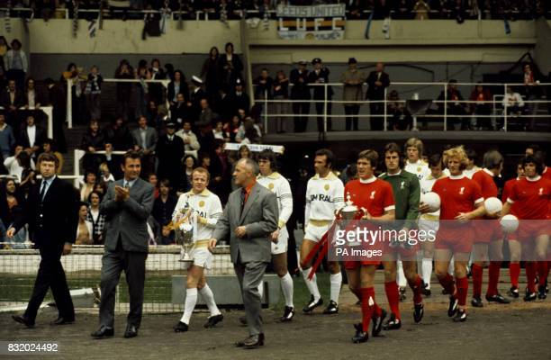Retiring Liverpool manager Bill Shankly and Brian Clough new manager of Leeds lead their teams out Liverpool collected the trophy when they won a...