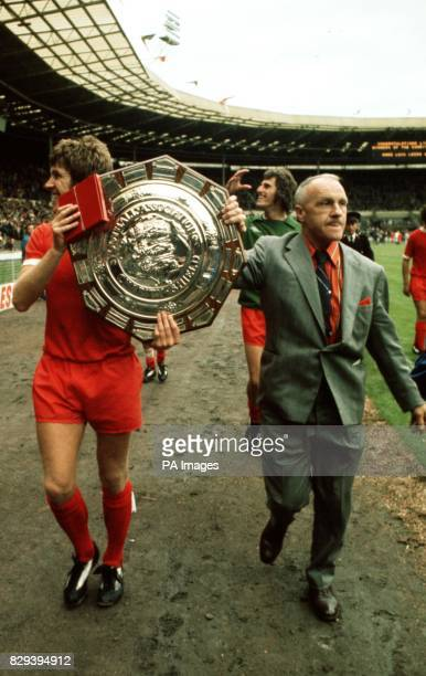 Retiring Liverpool manager Bill Shankly and club captain Emlyn Hughes parade the FA Charity Shield at Wembley after they defeated Leeds United in a...