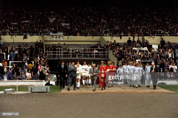 Retiring Liverpooll manager Bill Shankly and new manager of Leeds United Brian Clough lead out their teams for the FA Charity shield match at wembley