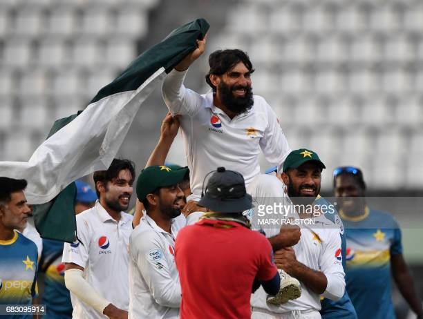 Retiring Pakistan cricket team captain MisbahulHaq is carried by teammates as they celebrate winning the final test match and the series 21 against...