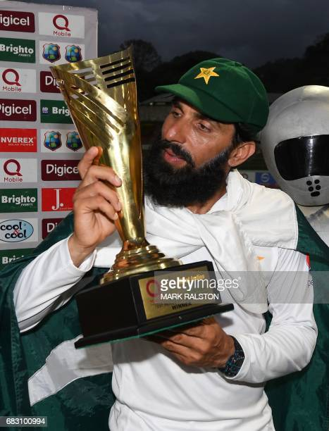 Retiring Pakistan cricket team captain MisbahulHaq kisses the series trophy after winning the final test match and the series 21 against the West...