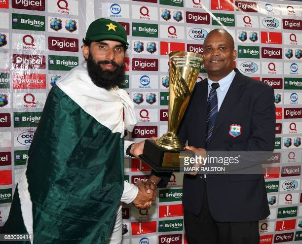 Retiring Pakistan cricket team captain MisbahulHaq receives the series trophy from the Vice President of the West Indies Cricket Board Emmanuel...