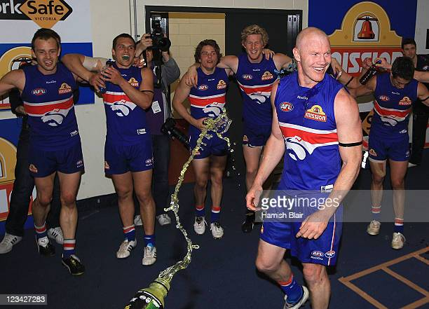 Retiring player Barry Hall of the Bulldogs celebrates in the rooms with team mates after the round 24 AFL match between the Western Bulldogs and the...