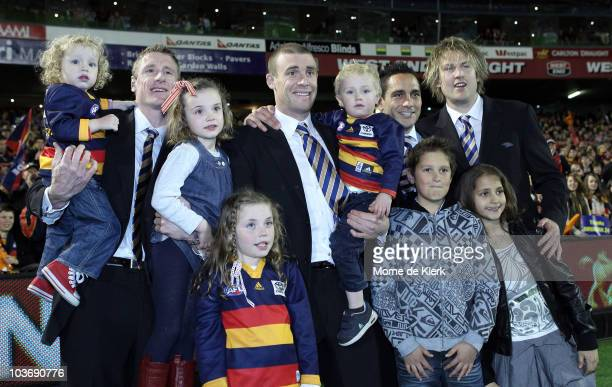 Retiring players of the Crows pose with their families after a lap of honour after the round 22 AFL match between the Adelaide Crows and the St Kilda...