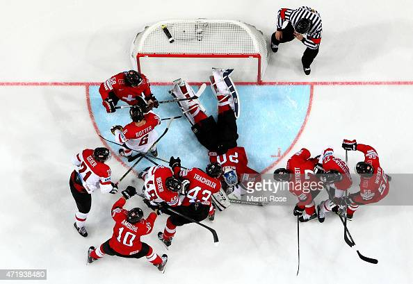 Reto Berra goaltender of Switzerland covers the puck during the IIHF World Championship group A match between Switzerland and Austria at o2 Arena on...