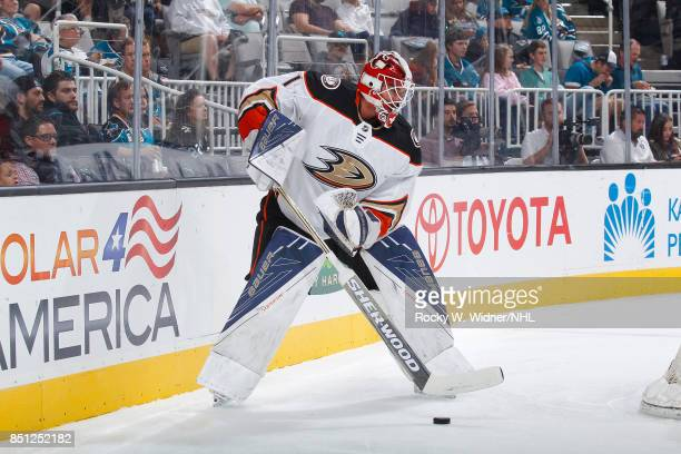 Reto Berra of the Anaheim Ducks controls the puck against the San Jose Sharks at SAP Center on September 19 2017 in San Jose California