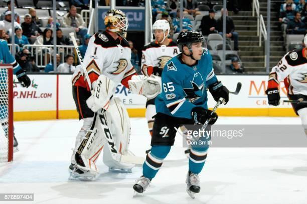 Reto Berra of the Anaheim Ducks protects the net as Daniel O'Regan of the San Jose Sharks looks on at SAP Center on November 20 2017 in San Jose...