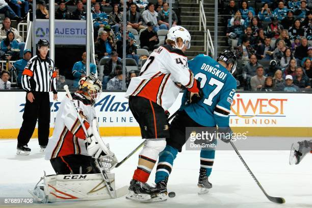 Reto Berra of the Anaheim Ducks protects the net as Hampus Lindholm of the Anaheim Ducks defends Joonas Donskoi of the San Jose Sharks at SAP Center...