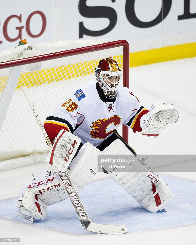 Reto Berra of the Calgary Flames defends the net during the game against the Minnesota Wild on March 3 2014 at Xcel Energy Center in St Paul Minnesota