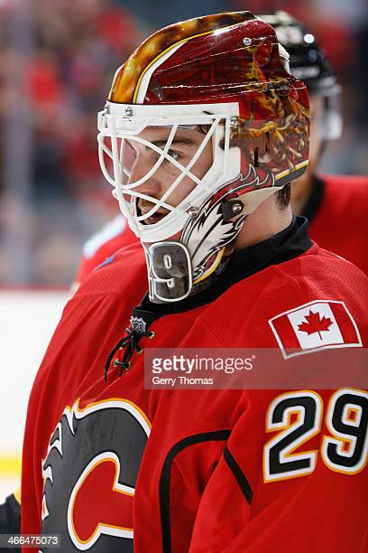 Reto Berra of the Calgary Flames during an intermission in a game against the Minnesota Wild at Scotiabank Saddledome on February 1 2014 in Calgary...