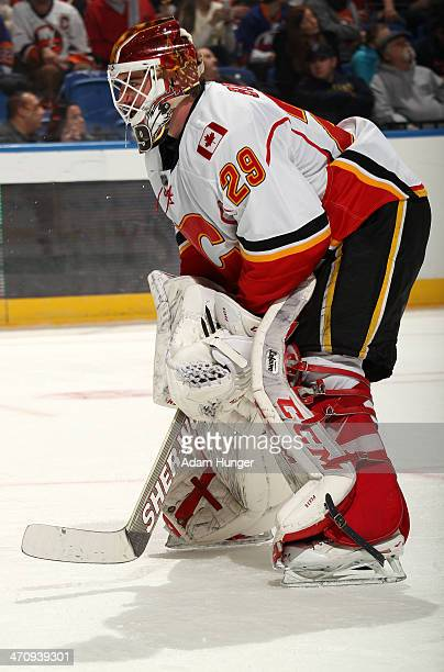 Reto Berra of the Calgary Flames in action against the New York Islanders at Nassau Coliseum on February 6 2014 in Uniondale New York